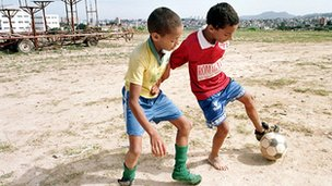 Young boys playing football in Sao Paulo