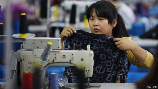 An employee works at a textile factory in Yiwu, Zhejiang province, China