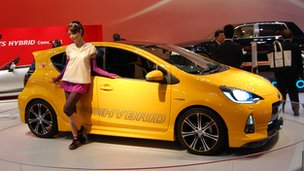 Japanese car and model at the Tokyo Motor Show