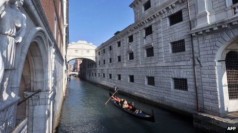 A gondola passes Venice's Bridge of Sighs after it was renovated (December 1, 2011)