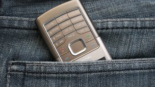 Mobile in trouser pocket