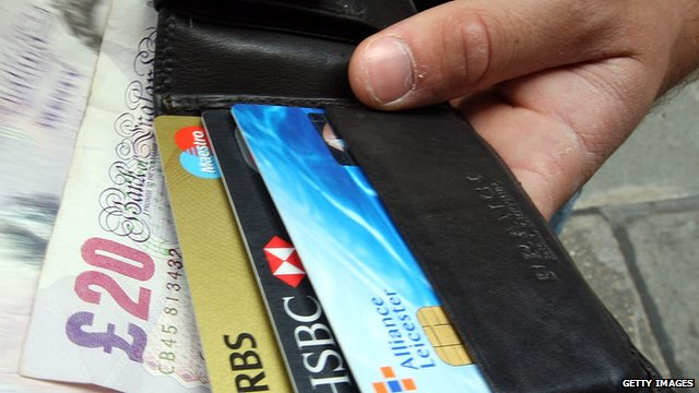 Man taking cash out of his wallet
