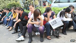 Bra factory workers out on strike in Shenzhen on 16 November 2011