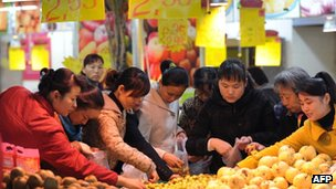 Shoppers select food at a supermarket in Anhui province (file image)