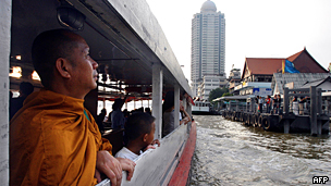 A Thai Buddhist monk rides a ferry on Bangkok's Chao Phraya river