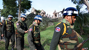 Cambodian soldiers patrol past the Preah Vihear temple near the Thai border