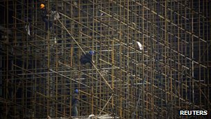 Workers on scaffolding in Beijing