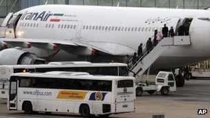 Iranian diplomatic staff board a plane at  Heathrow Airport, in London