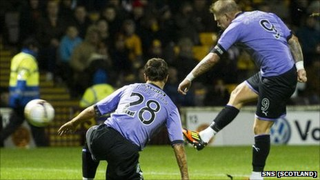 Hibs striker Garry O'Connor gives the visitors the lead at Fir Park