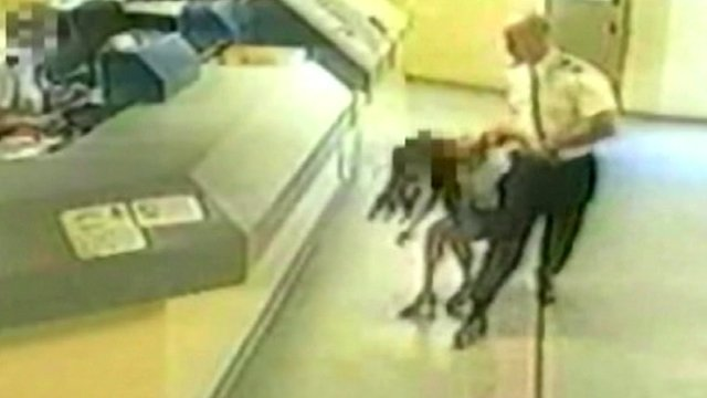 Sgt Mark Andrews dragging Pamela Somerville on CCTV in July 2008