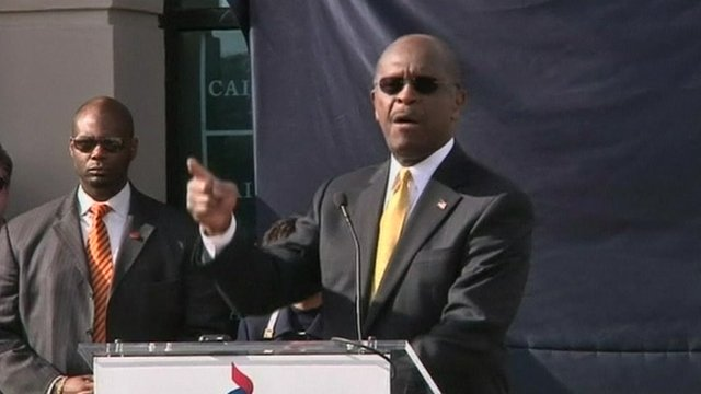 Herman Cain speaking outside campaign headquarters.