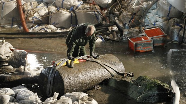 Bomb disposal expert examines bomb