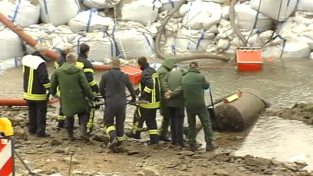 Bomb disposal team next to bomb
