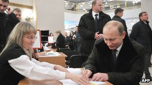 Vladimir Putin casts his vote in the parliamentary elections