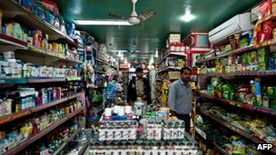 Indian customers browse the shelves inside a departmental store in New Delhi