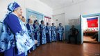 The Russian Soul amateur folk ensemble performs at a polling station during the parliamentary election in the village of Verkhniaya Biryusa in the Taiga area, south of the Siberian city of Krasnoyarsk