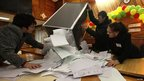 "Electoral commission staff empty a ballot box after voting closed at a polling station in the village of Ust-Mana some 30 km (19 miles) from Russia""s Siberian city of Krasnoyarsk"