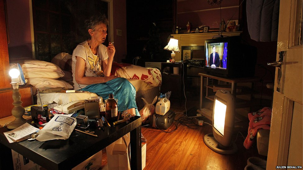 Marcia Kinsella watches Taoiseach Enda Kenny's state of the nation address on television in her flat in Dublin
