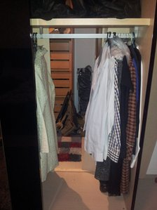 View through Naser Rayes' wardrobe into his secret room