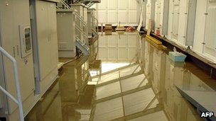Radioactive water on the floor of a water treatment facility at the Fukushima Daiichi nuclear plant on 4 December 2011