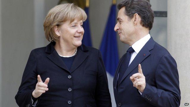 French President Nicolas Sarkozy (R) greets German Chancellor Angela Merkel (L)