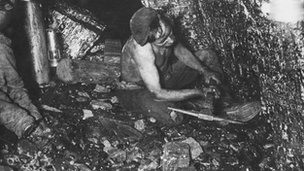 A British coal miner at work in 1915