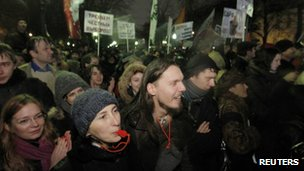 Participants blow whistles and shout during an opposition protest in central Moscow on 5 December 2011