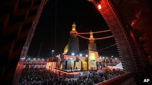 Pilgrims gather at the Imam Abbas shrine in Karbala, 26 December