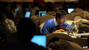 Indian information technology professionals work on their laptops during an Open Hack Day programme in Bangalore, Jul 2010