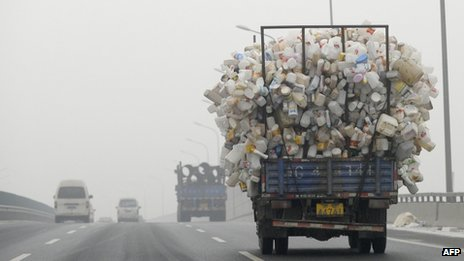A truck carrying bottles drives in Beijing on 5 December 2011