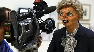 A cameraman films the Spitting Image puppet of Margaret Thatcher at the Rude Britannia: British Comic Art exhibition