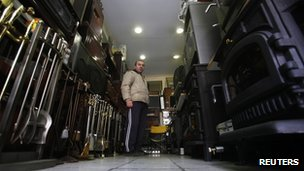 Costas Mitsionis, 42, stands among stoves inside his shop in Athens 23 November 2011.