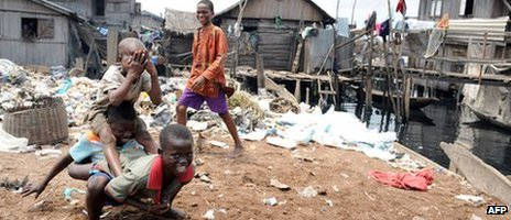 Children play in a slum in Lagos on 29 September 2011