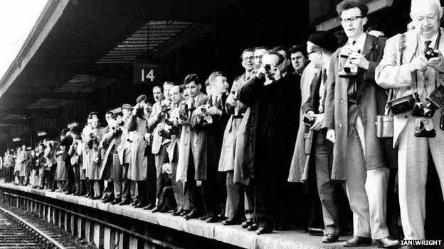 Photographers on platform 14 at York Station wait for The Beatles to arrive, 9 August 1964