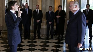 New Belgium PM Elio Di Rupo takes the oath of office in front of King Albert II at  the Laeken Royal Palace in Brussels on 6 December 2011