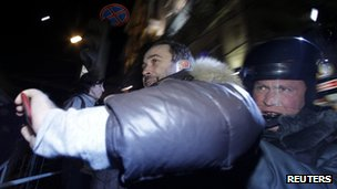 Police detain a protester in Moscow, 6 December