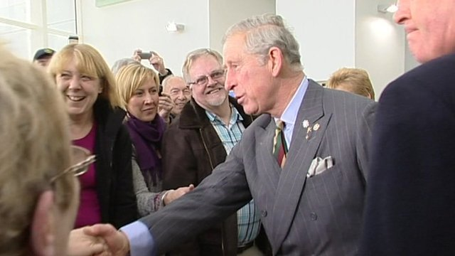 Prince Charles greets a crowd