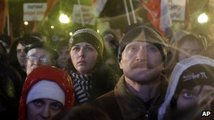 Russian opposition members listen during a rally in Moscow, 5 Dec 2011