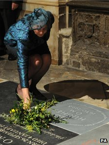 Carol Hughes lays flowers on Ted Hughes&#039;s memorial stone