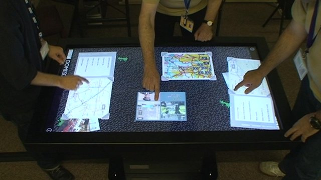 The team at The National Museum of Computing at Bletchley Park try out the new interactive Domesday Project touchtable