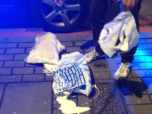 Man with burst bag of white paint in Islington