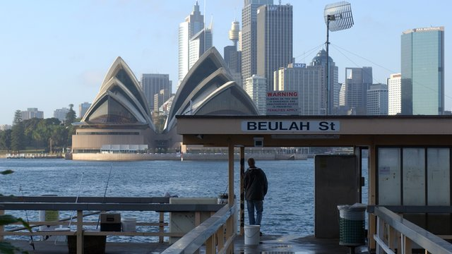 A view of the Sydney Opera House from a ferry terminal in the harbour.