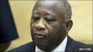 Ivory Coast's former president Laurent Gbagbo waits for the judges to arrive for his initial court appearance