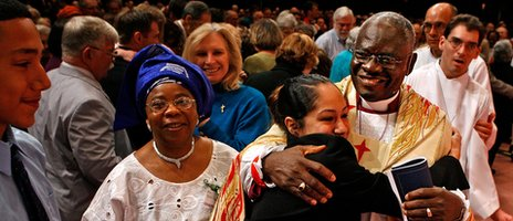 Nigeria's Anglican Archbishop Peter Akinola (R) is embraced by congregants during the investiture of the Right Rev. Martyn Minns as the missionary bishop of the Convocation of Anglicans in North America (5 May 2007)