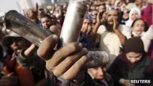 A protester displays empty tear gas canisters during clashes with riot police at Tahrir Square in Cairo (22 November 2011)
