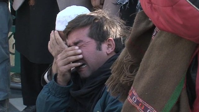 A mourner after 59 people were killed on Tuesday