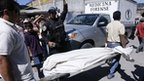 Forensic workers carry the body of journalist Luz Marina Paz