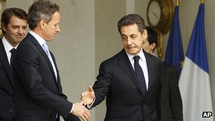French President Nicolas Sarkozy, right, accompanies US Treasury Secretary Timothy Geithner in Paris on 7 December 2011