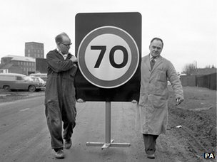 Workers with a new 70 mph road sign in 1965