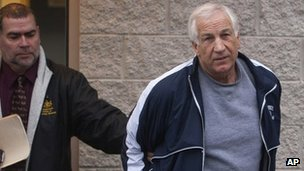 Jerry Sandusky, leaves the office of Centre County District Justice 7 December 2011